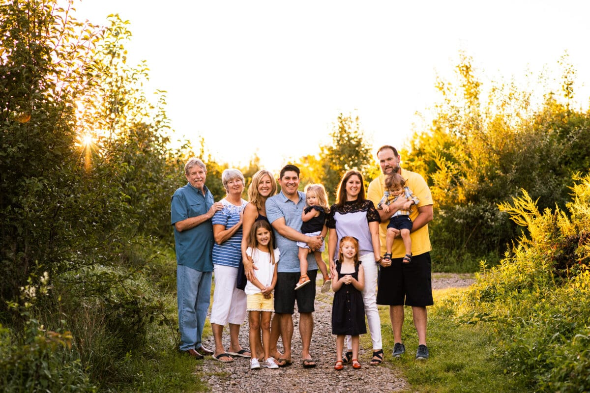 extended family together in an outdoor location at sunset in northern virginia