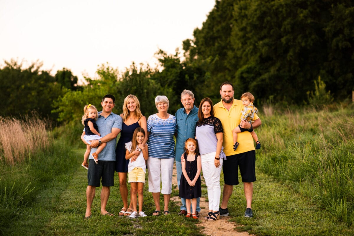 grandparents with their kids and grandkids in a field at sunset family photography