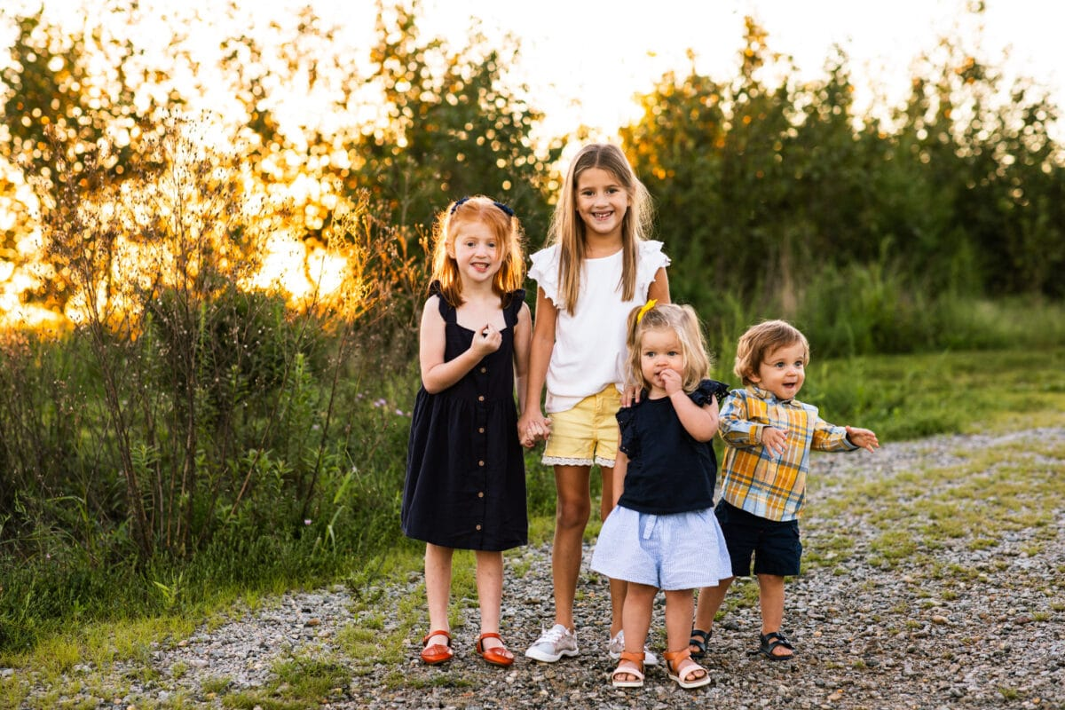 group of kids smiling at an extended family session in northern virginia