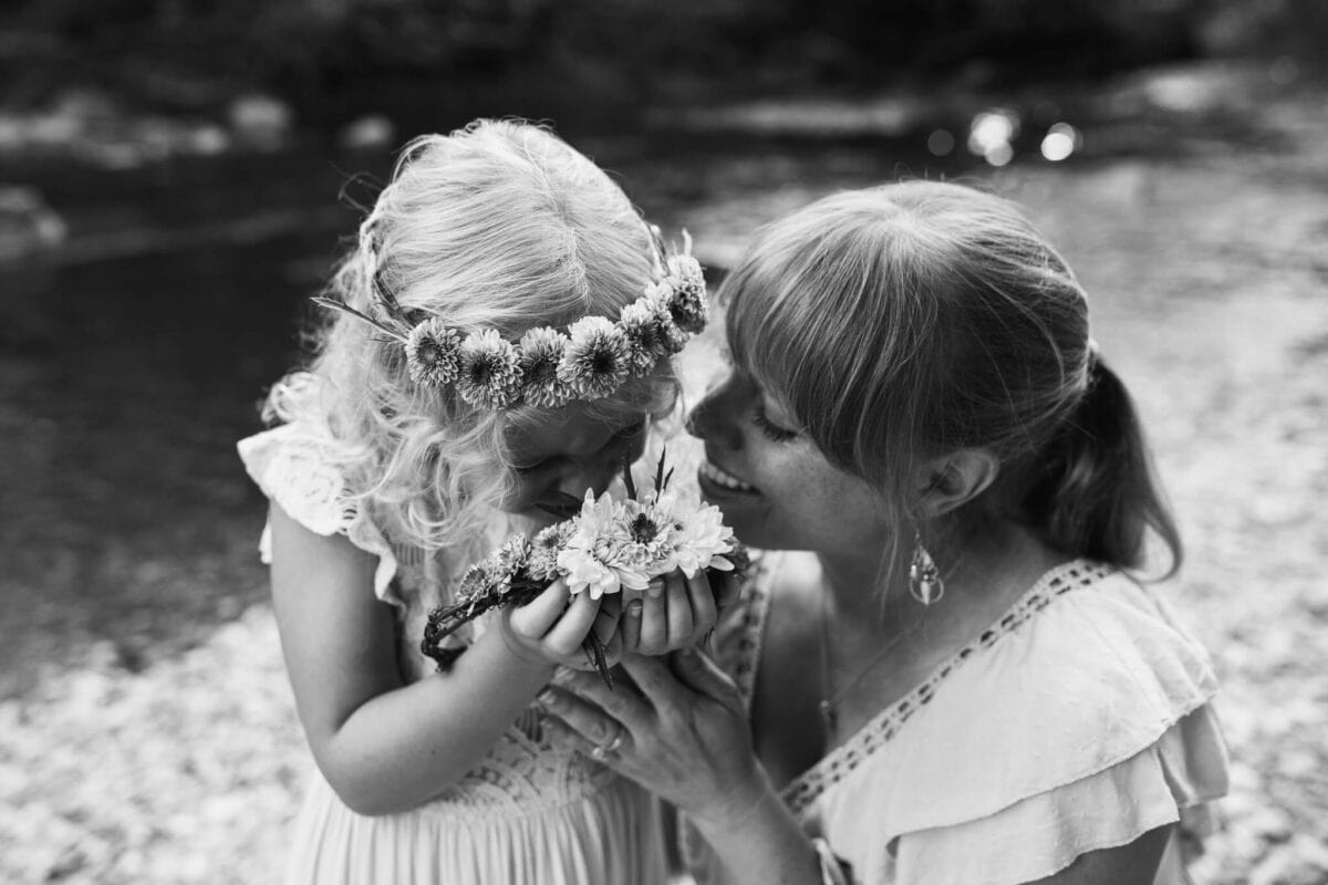 black and white image of mother and daughter smiling looking at each other